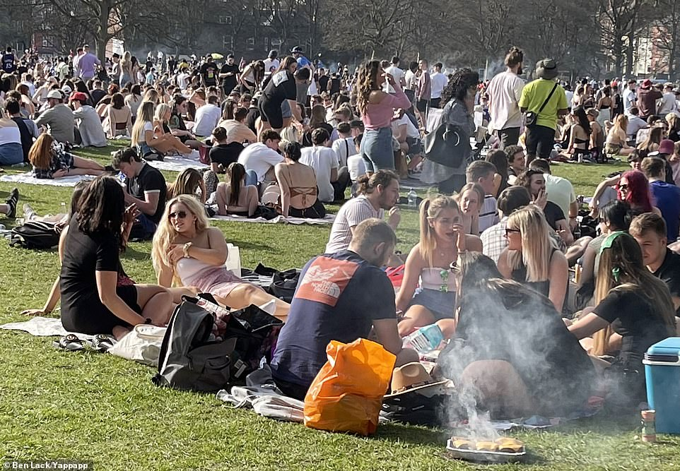 People had barbecues as they sat outside in the sunshine at Woodhouse Moor in the Hyde Park area of Leeds this afternoon