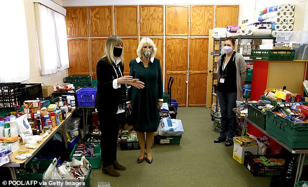 Camilla was shown through the church and around the stockroom by Fitzjohn's foodbank's chairman Roz Bassford (pictured)