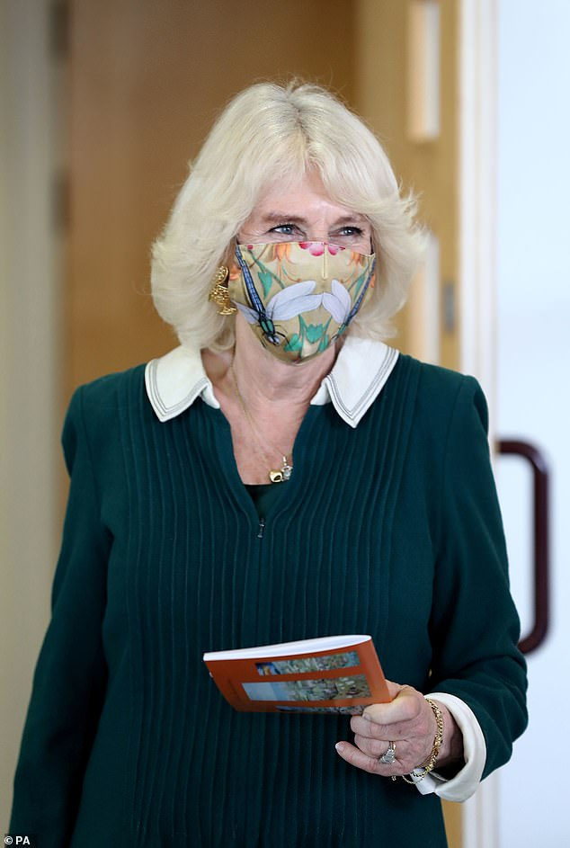 Camilla sported a colourful golden face covering embellished with colourful dragonflies to keep herself protected while visiting the church