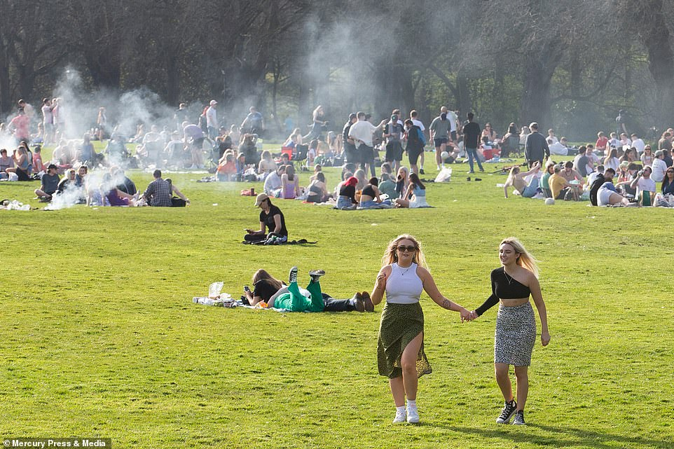 Barbecues billowed smoke into the air in Liverpool's Sefton Park this afternoon as Britons rushed to enjoy the warm weather