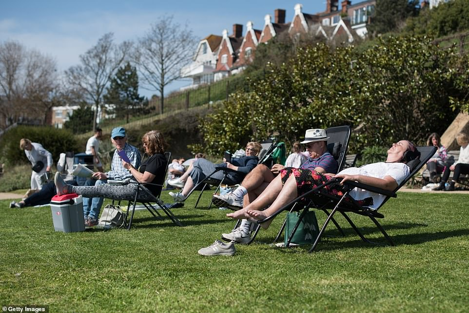 Some Britons took out sun loungers as they relaxed on the green opposite the beach in Westcliff, Southend