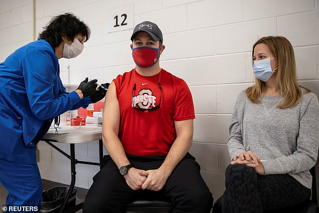 Another 18.2% said vaccines would be ineffective within two years while 7.8% said they believed mutations would never cause vaccines to become ineffective. Pictured: Jake Lawler, receives his coronavirus vaccine in Lima, Ohio, March 29