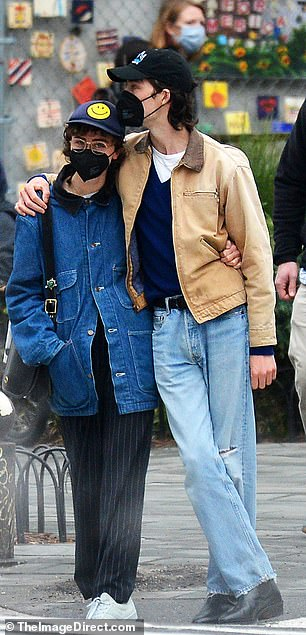 Match: Spotted in the West Village, the couple seemed in tune with their outfits. Ella wore an oversize denim jacket and pinstripe wide-leg pants with a smiley face baseball cap.