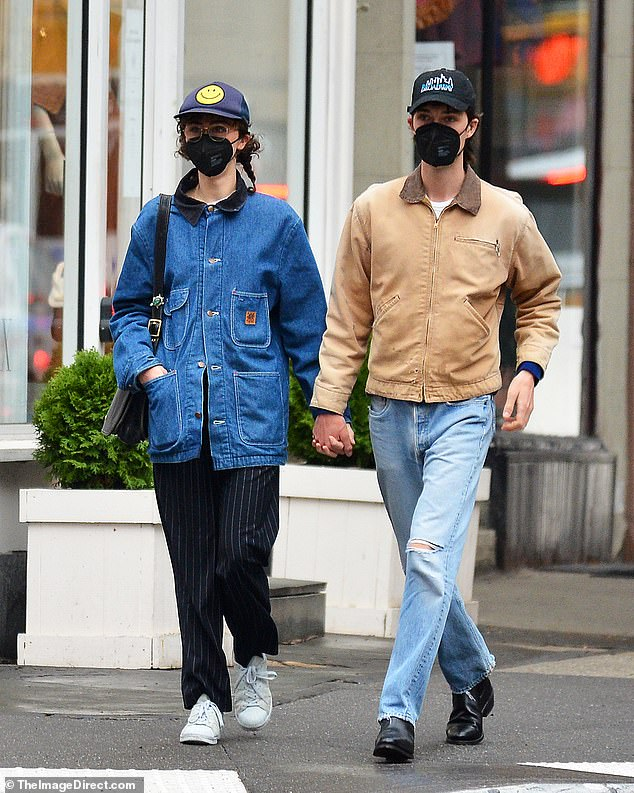 Hand in hand: The duo haven't confirmed their relationship but looked very friendly on the outing
