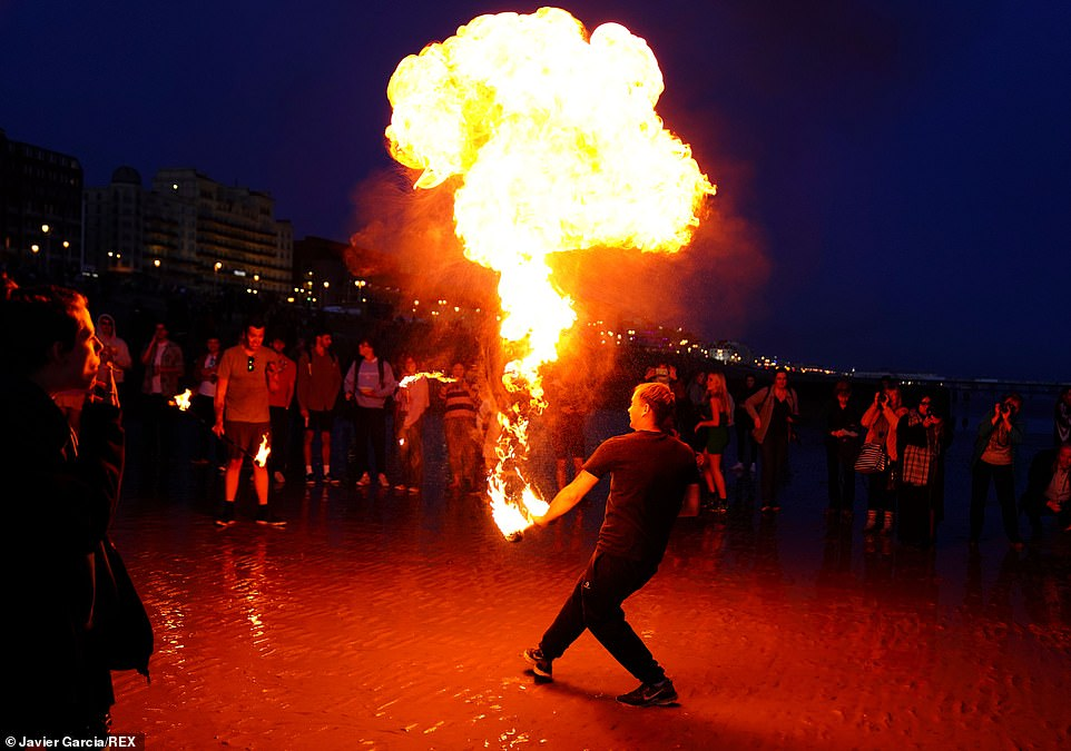 In Brighton, celebrations continued well into the evening with beachgoers erupting into an impromptu party with flame throwers as huge crowds gathered to watch