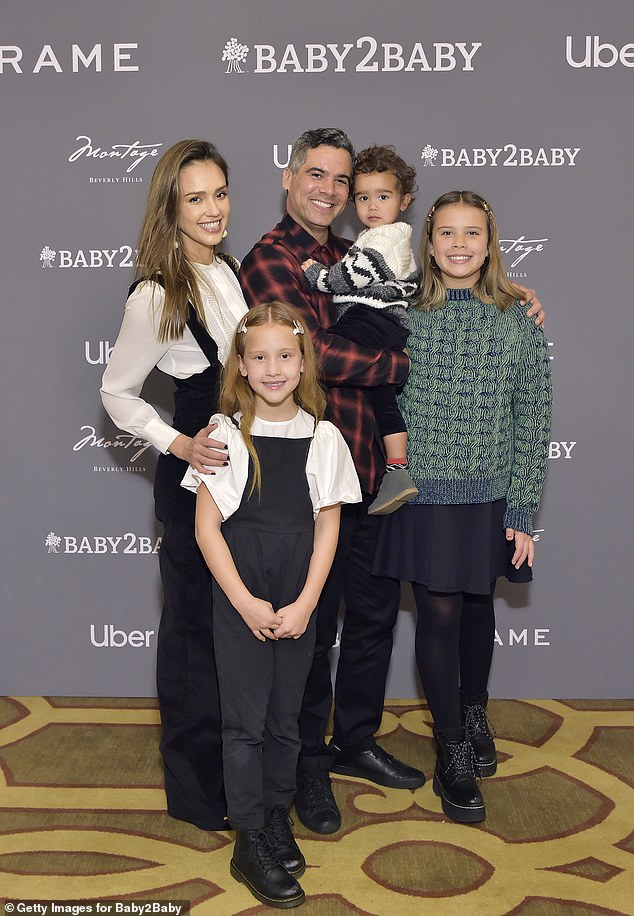 Along with Honor, Alba and husband Cash Warren are the proud parents to daughter Haven, nine, and son Hayes, three; the family of five are pictured in December 2019