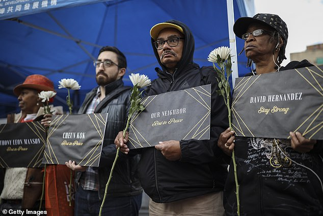Mourners attend a vigil for four homeless men who were murdered in New York City's Chinatown in October 2019