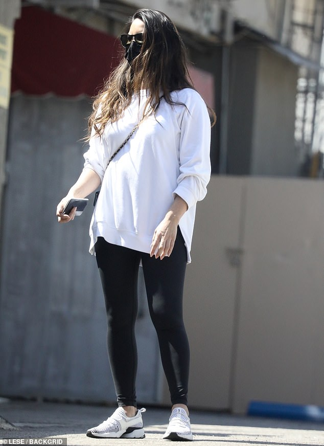 Two colors:The 40-year-old actress donned a plain white sweatshirt and black leggings for her workout along with matching black-and-white Avre sneakers