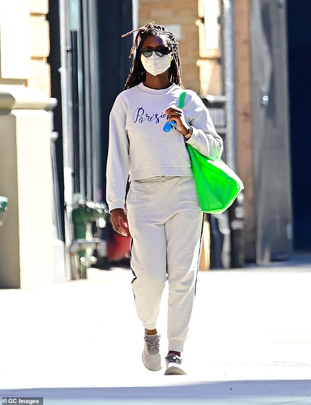 Stayed safe: She stepped out in trainers, carried a green reusable shopping bag and made sure to cover up with a face mask