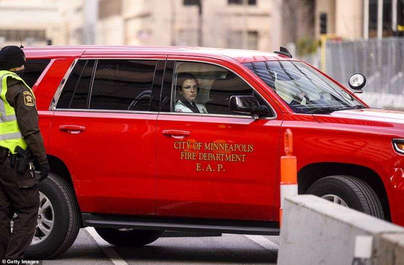 Genevieve Hansen is driven away from court in a City of Minneapolis Fire Department vehicle after her dressing down from the judge on Tuesday. She will return to court on Wednesday