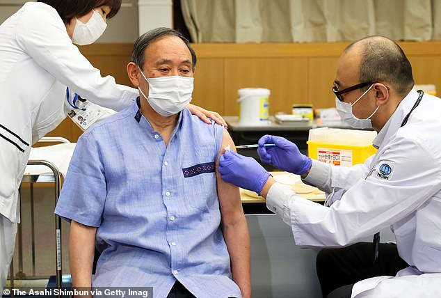 Japan's vaccination campaign is months behind other rich countries including the United Kingdom and United States. Pictured: Prime Minister Yoshihide Suga received the first dose of a Covid-19 vaccine in Tokyo on March 16 [File photo]