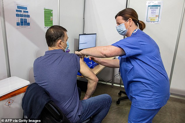 Northern Ireland has today officially expanded its coronavirus vaccine rollout to people under the age of 50, becoming the first home nation to do so. Pictured, a vaccine centre in Belfast
