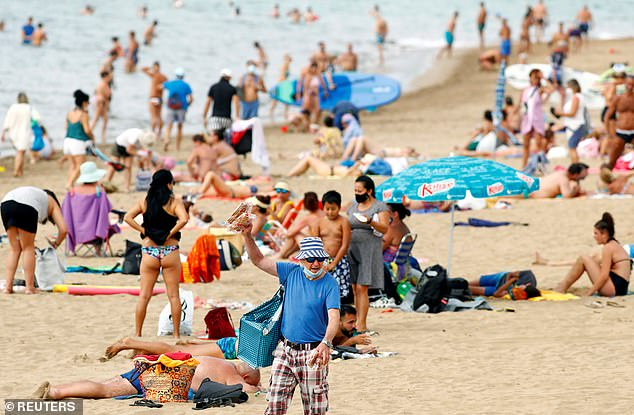 Following pleas from a group of 40 MPs on Monday, industry leaders from the British Chambers of Commerce, Federation of Small Businesses and UK Hospitality said the economic recovery would be put at risk if overseas trips remained illegal. Pictured: A beach in the Canary Islands