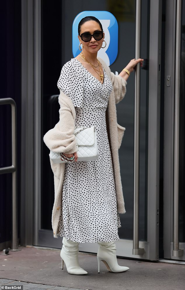Fashion:The media personality added height to her frame with a pair of while boots while she accessorised with a matching handbag