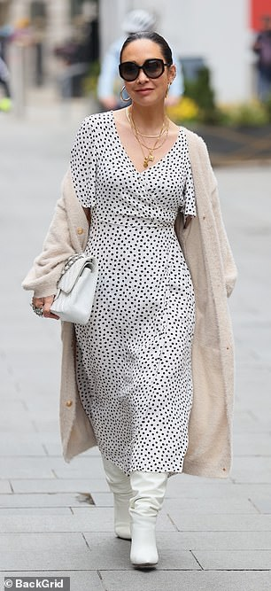 Outfit: The presenter, 42, was dressed for spring as she donned a white midi dress with a polka dot print and a deep v-neckline