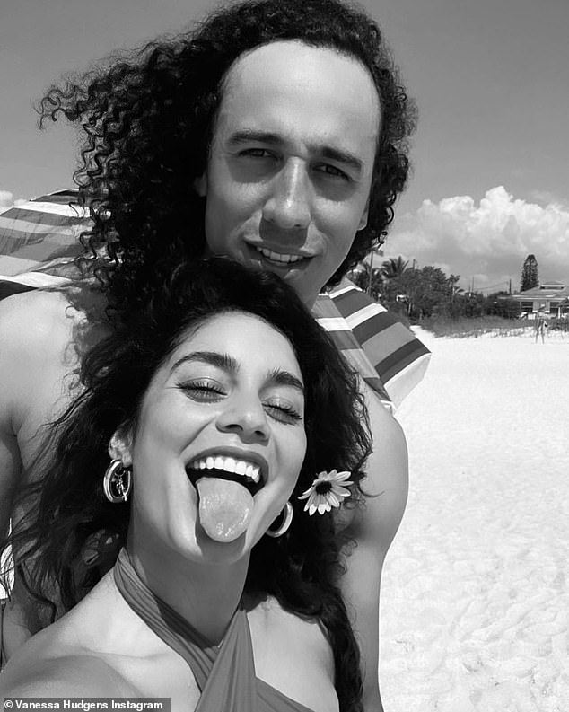 Lovebirds: Vanessa Hudgens shared a black and white selfie of herself playfully sticking out her tongue as she posed for a sweet selfie with her boyfriend Cole Tucker in Florida