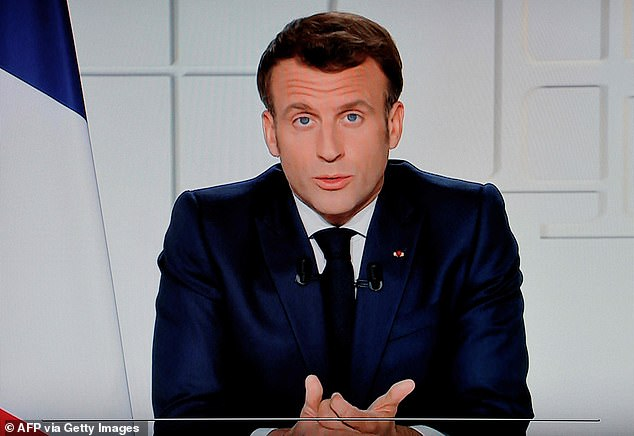 France will enter a third national lockdown for four weeks, French president Emmanuel Macron announced in an address to the nation on Wednesday night, expanding current measures in 19 territories to the whole country. Pictured: Macron seen on TV on Wednesday night