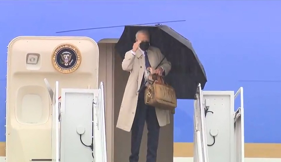 President Joe Biden gives a salute as he successfully navigates the stairs of Air Force One after his memorable tumble en route to Atlanta, Georgia earlier this month