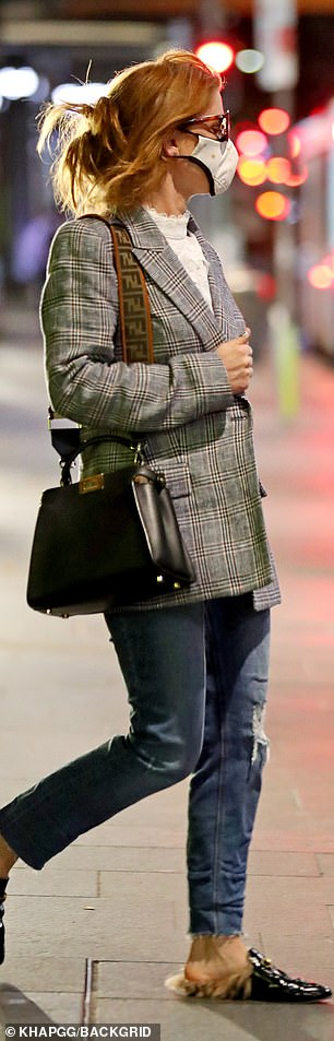 Expensive taste: She also carried a $7,100 Fendi bag
