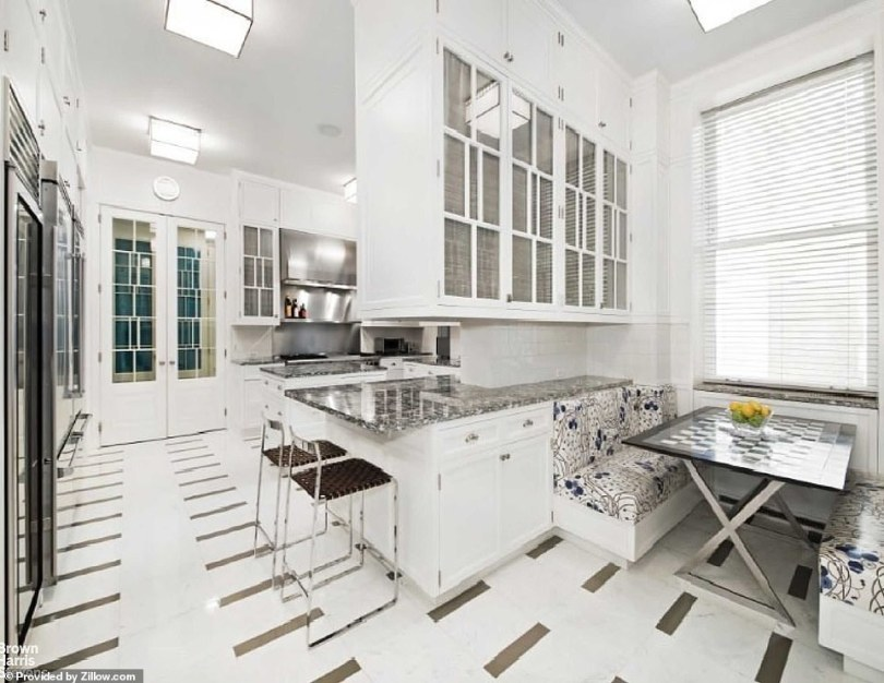 A marble and stainless kitchen with a breakfast room can accommodate a large apartment staff or caterers