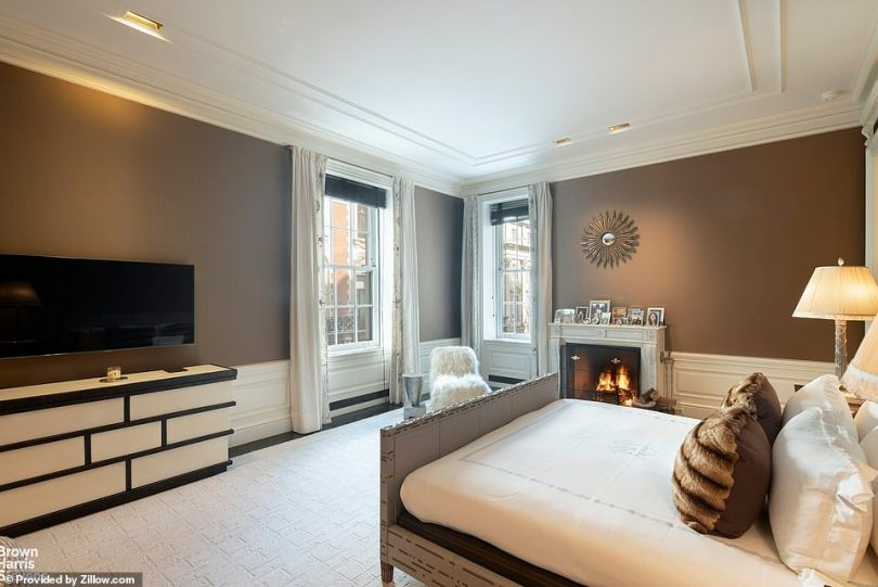 Working wood fires are a feature in the full-floor home inside the building along Central Park