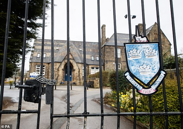 Purpose of Life has since removed the teacher's name from its online post and was reported to the Charity  Commission. Pictured: Chained gates at Batley Grammar School in West Yorkshire