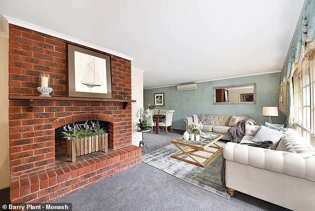 Cosy: Upon entry the home leads to a living room that features a brick fireplace, and formal dining room