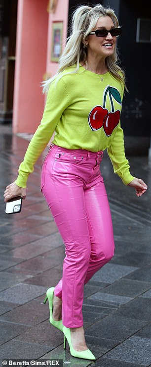 Boost her petite frame:Contrasting against the dreary British weather, Ashley teamed her vinyl Fiorucci trousers with neon green stilettos