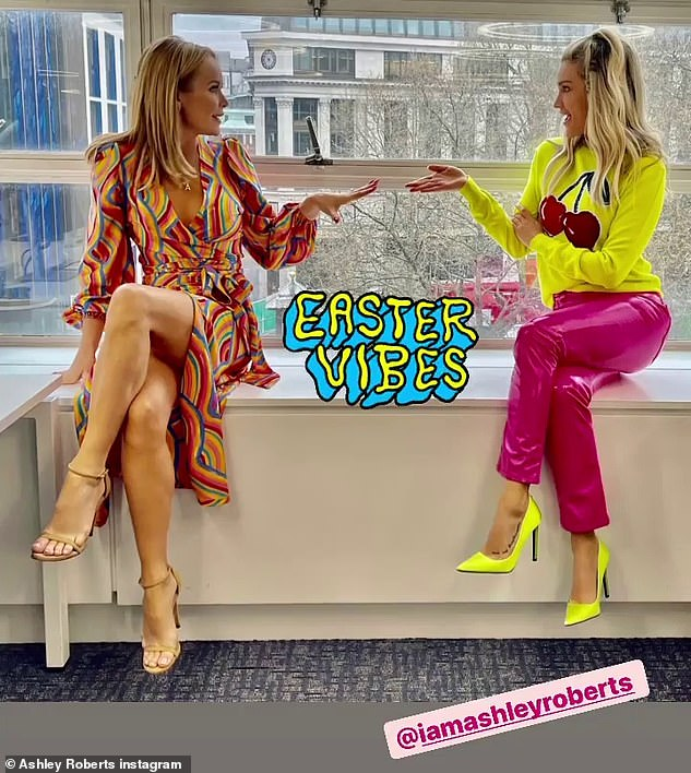 'Easter vibes': She also uploaded a snap from Amanda Holden's Instagram account, as her co-host, 50, wowed in a rainbow printed dress complete with a plunging neckline