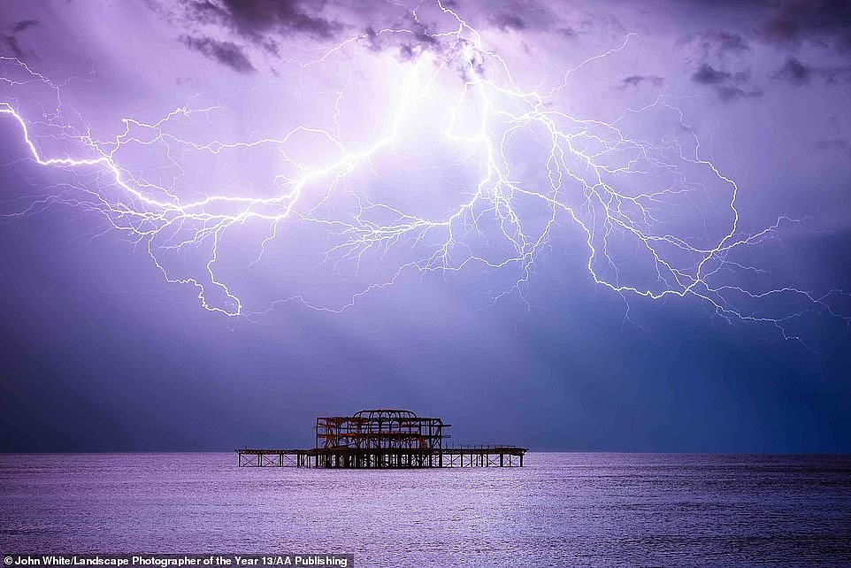 This shot, by photographer John White, was a long time in the making. He called it The Kraken and explained: 'After three years of trying, finally I found myself in the right place as the tentacles of the kraken reached down from above to reclaim the old West Pier, Brighton.' He entered it into the Classic View adult class category in the 2020Landscape Photographer of the Year competition
