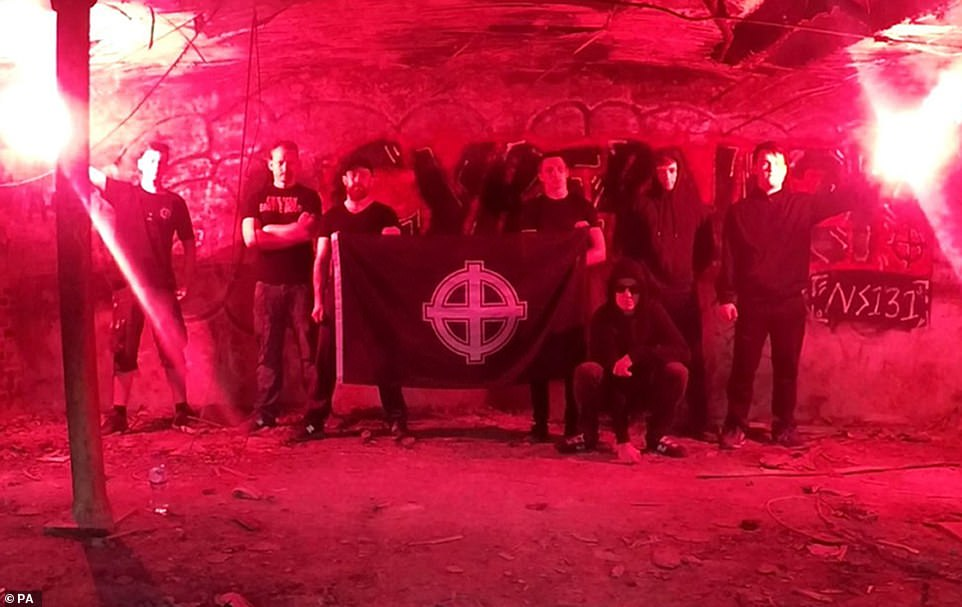 Hannam (second right) seen during a neo-Nazi gathering in images shown to jurors