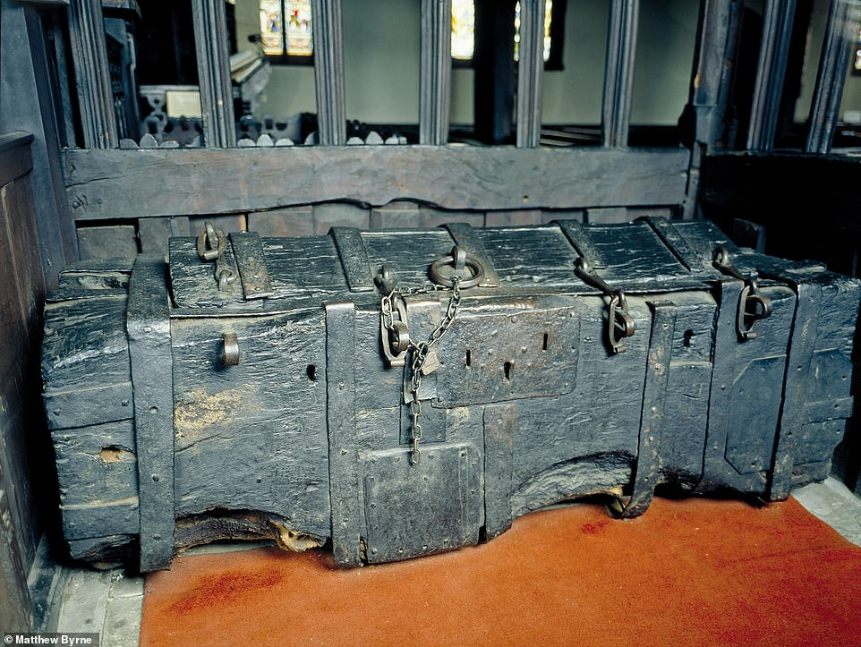 ST OSWALD'S CHURCH, LOWER PEOVER, CHESHIRE: A medieval chest, 'amply padlocked to protect church plate and vestments'