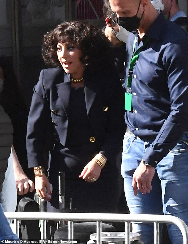 Striking: She has been hard at work filming House Of Gucci in Milan. And Lady Gaga looked in high spirits as she spent another day on set in her role of 'Black Widow' Patrizia Reggiani