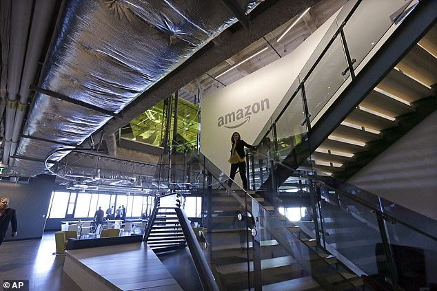 Meanwhile, Amazon (file image) confirmed Wednesday that the company still plans to have its employees return to the office by fall