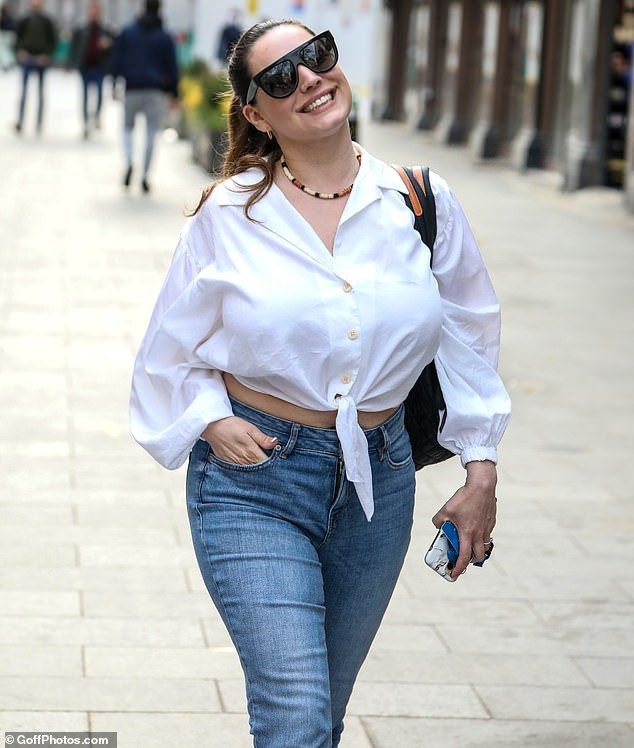 Style icon:Clearly enjoying the early April sunshine, Kelly beamed as she made her way into the Global building