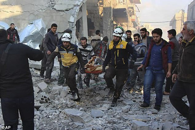 Rescue teams evacuate a victim after airstrikes hit a village in the Idlib province of Syria