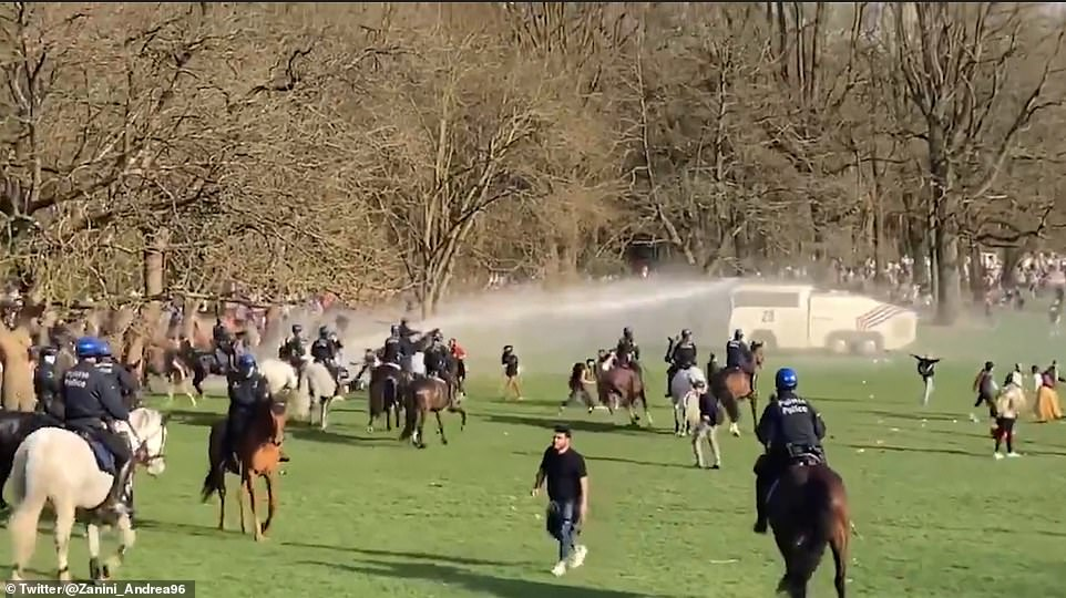 More than 2,000 Belgians (pictured being dispersed) rushed to Bois de la Cambre park in Brussels to attend the fake 'La Boum' festival which was announced on Facebook as a joke