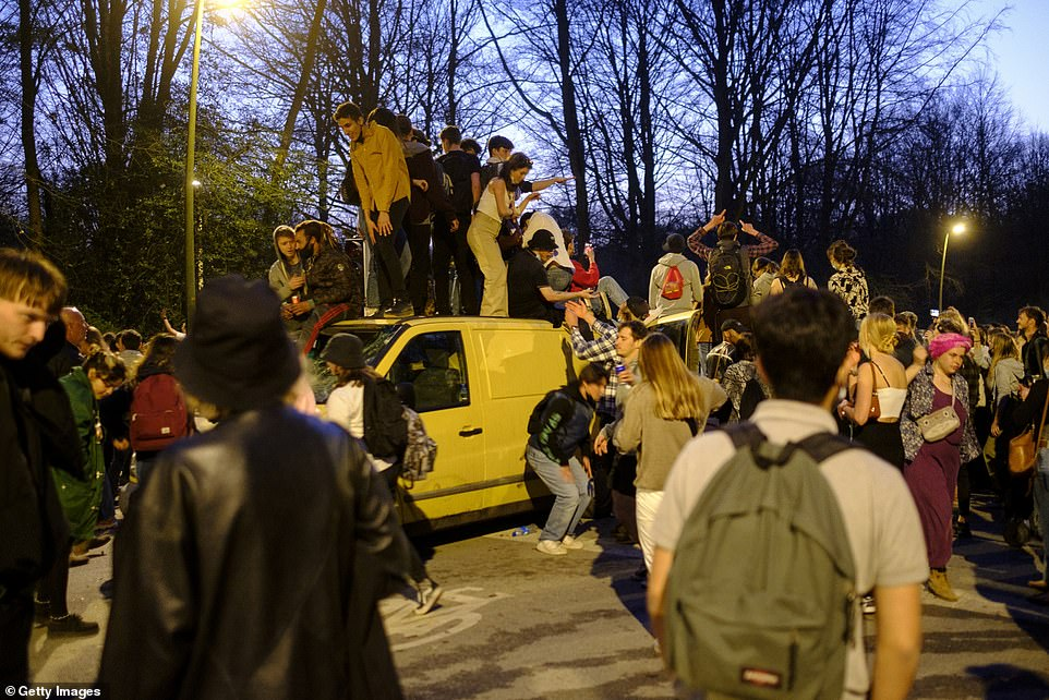 Revellers remained at the park into the night. Several were seen standing on a van