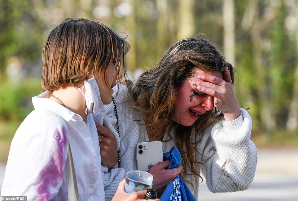 A woman is seen clutching her head and crying after the fakeLa Boum lockdown party descended into chaos