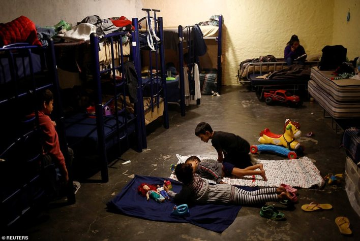 Asylum-seeking migrant children from Central America, who were airlifted from Brownsville to El Paso, Texas, and deported from the U.S. with their mother, play inside the El Buen Samaritano shelter in Ciudad Juarez, Mexico on Thursday