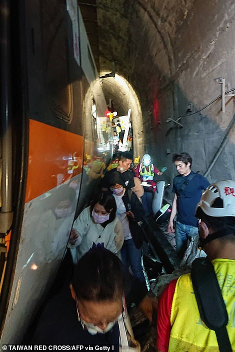 Passengers scramble out of the tunnel