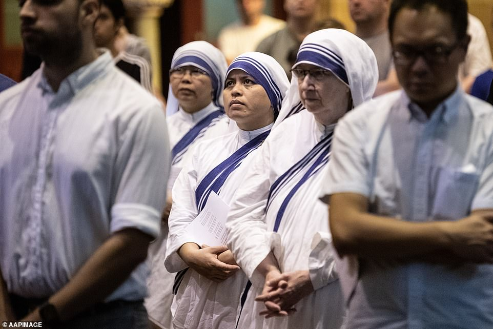 AUSTRALIA: Nuns take part in a service at St Mary's Cathedral in Sydney on Friday
