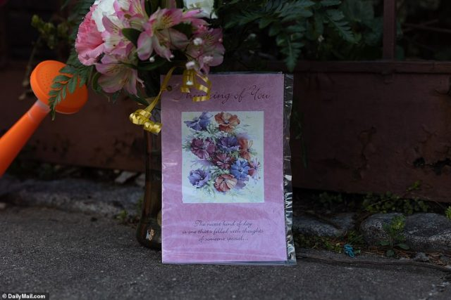 Friends and neighbors have laid cards and flowers outside the College Point residence after Sakash was found inside Tuesday