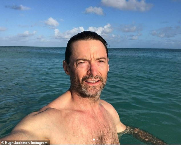 He captioned the photographs, in which he is squinting in the bright sunshine: 'I've been double dipped in SPF 100'
