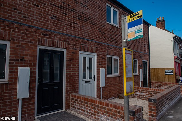 The local council confirmed the bus stop, pictured, will be moved before the new owners move into the three-bed, £175,000 property