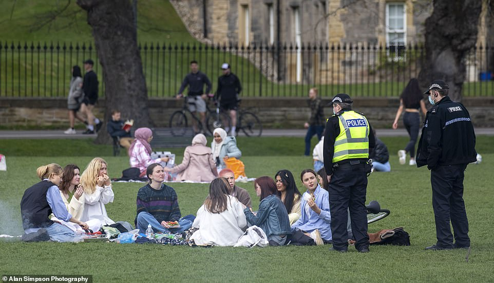 Police approach a large group of young women at The Meadows in Edinburgh, with the rule of six still in force this weekend