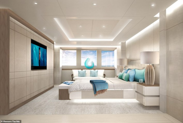 Aura comes with five staterooms able to accommodate 10 guests, with the owner's suite (pictured) located forward on the main deck and the remaining guest cabins down below