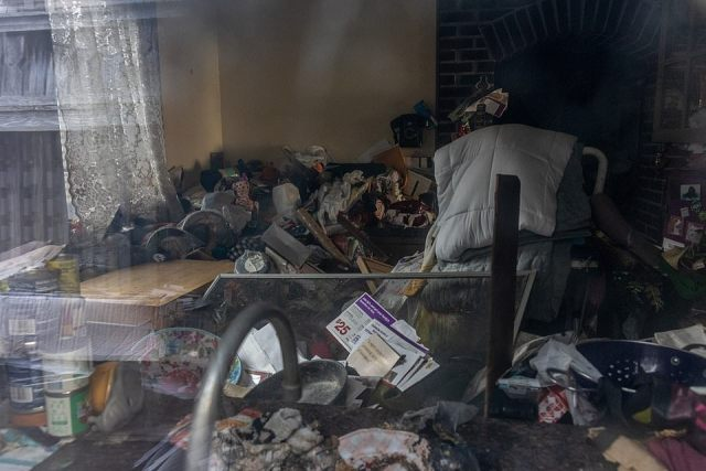 Last October, officers conducted two searches of the home, digging beneath 'floor to ceiling' debris for the missing production designer. The interior of her home is pictured