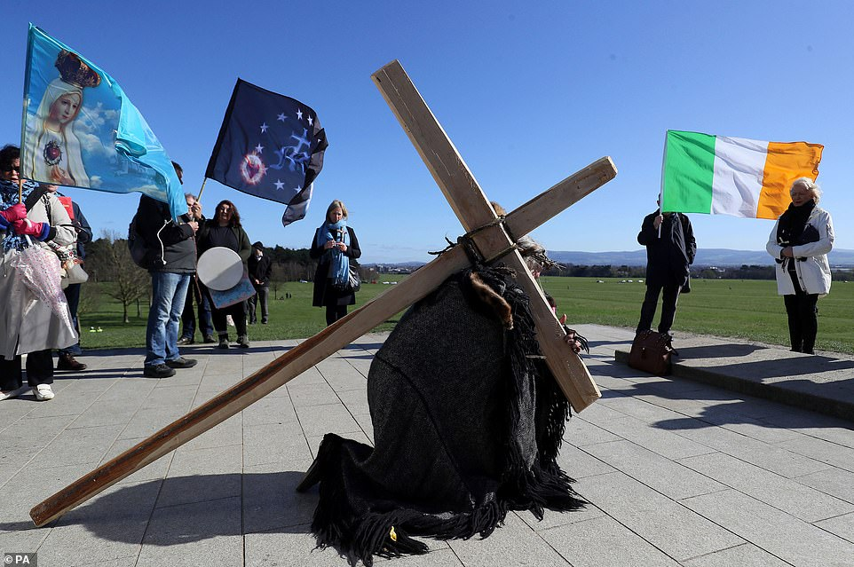 IRELAND: People take part in a Solemn Procession on Good Friday at the Papal Cross in Dublin's Phoenix Park, as churches remain closed due to coronavirus restrictions