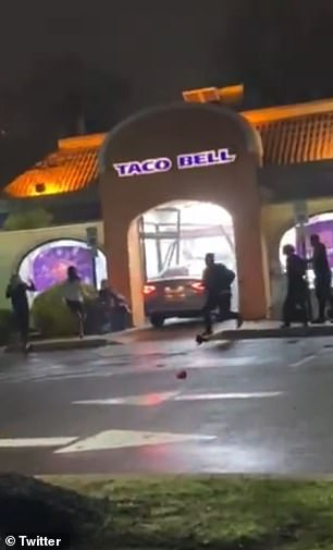 After plowing into the group, the driver crashes into the restaurant